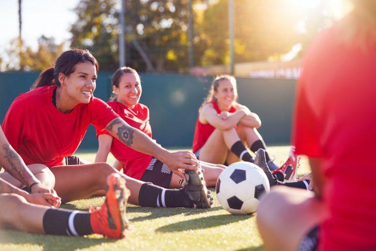Womens Football Team Stretching